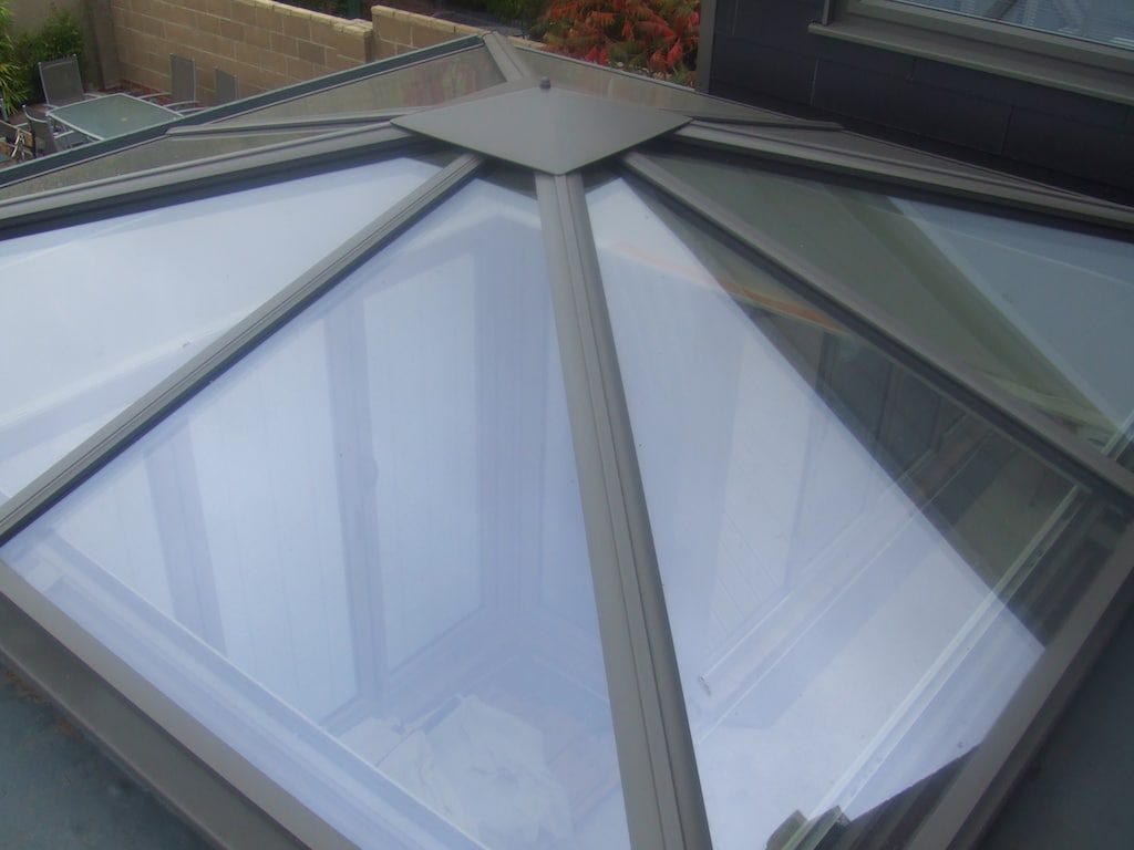 glass or solid conservatory roof